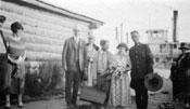 Claude and Mary on their wedding day, perhaps with the Burkes. The S.S. Yukon is in the background. The steamer and her crew played a large role in the Tidds' wedding day.